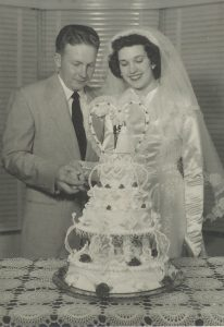 Gaye and Hartley Anderson, whose life story is told in Every Essential Element, cut their wedding cake, 1952