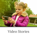 Video Stories - a workshop by Evalogue.Life. Photo of an 8-year-old girl watching a video on a smartphone.