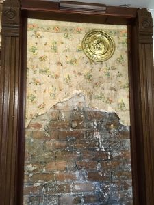 Wallpaper and chimney brick we found behind a false wall in our kitchen.