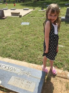 Family reunions and family vacations are a perfect time to make memories and tell stories. Photo of Rachel Trotter's daughter visiting a family grave on a vacation.