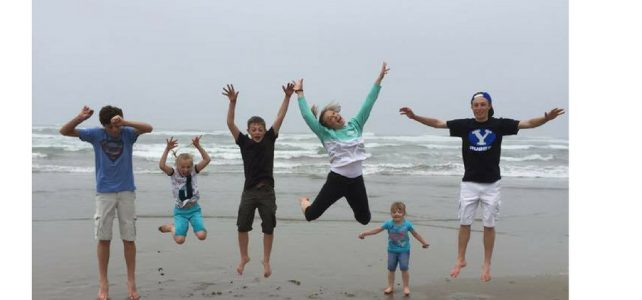 Family reunions and family vacations are a perfect time to make memories and tell stories. Photo of Rachel Trotter's children jumping into the air on the beach during a family vacation.