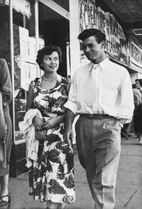 Jim and Norma Kier while they were dating in the 1950s. This photo of them dressed nicely is taken while walking down the street of Edmonton Canada in the 1950s. Jim Kier was a wonderful business storyteller.