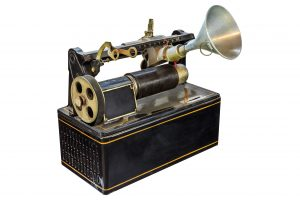 Photo of an antique dictaphone - TranscribeMe is a great transcription service to replace tedious methods of transcribing audio yourself.