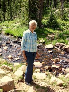 Before losing my mom to dementia, we wrote her story. Here she is standing by a stream in the back country when we got away for a weekend to write her story.