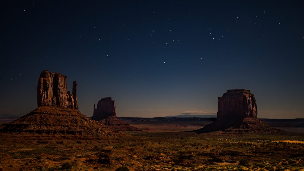 Photo credit: nico-kramer-450511-unsplash. A nighttime photo near \the 4-corners area where Laura Hedgecock had a powerful experience listening to stories