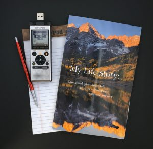 An oral history kit: digital recorder, My Life Story booklet of questions and pen