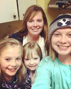 One of Rachel's Thanksgiving traditions involves making pies the night before. Here she is with her daughters on that night.