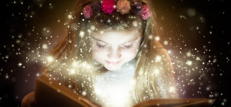 Power of story - girl reading a storybook and fairy dust coming from page