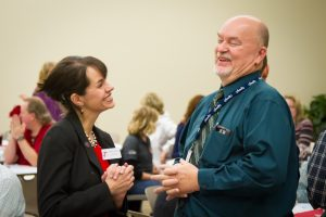 Rhonda Lauritzen as Vice Preisdent at the Ogden-Weber Technical College smiling with a colleague