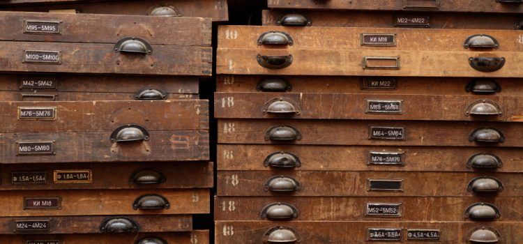 Old wooden file drawers - Services like TranscribeMe sure beat the old methods.