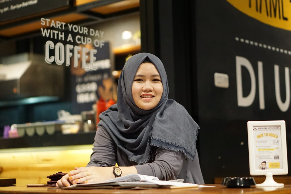 Listening to stories of people from other cultures opens doors of understanding. Here a Muslim woman in a coffee shop like the one who engaged Laura Hedgecock. Photo from Upsplash.