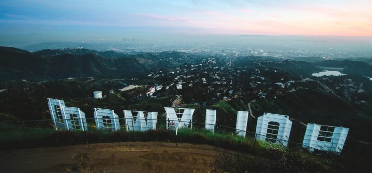 Want to learn how to write al life story? Author Ray Raymond shares tricks of the trade from his career as a Hollywood entertainment journalist. Photo of the Hollywood sign taken from behind with the letters in reverse. Photo by Jeremy Bishop on Unsplash