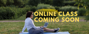 Online class coming soon - photo of a woman outside with her laptop on a blanket in front of a garden